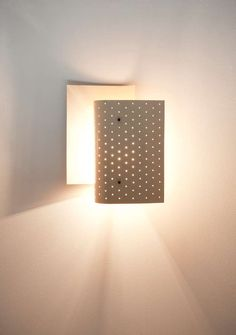Michel Buffet; #B205 Painted and Perforated Metal and Brass Wall Light for Luminalite, c1950.