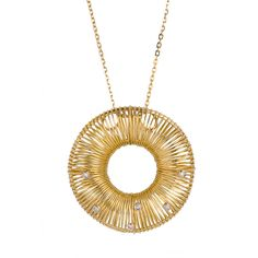Yellow gold wire pendant with diamonds. Available at www.yanina-co.com, 800-780-3433.