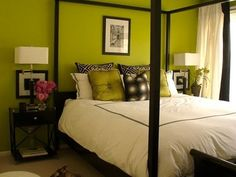 This Eclectic Bedroom has: white bedding green and black pillows green painted walls canopy bed frame black wood night stand black framed art white Beautiful Bedrooms, Home, Green Rooms, Bedroom Design, Bedroom Wall Paint Colors, Bedroom Colors, Eclectic Bedroom, Canopy Bed Frame, Lime Green Bedrooms