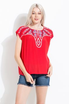 The pastel blue and white embroidery on this top add the perfect feminine detail! Great with jeans as a casual outfit.