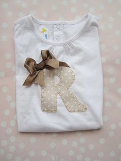 Tan letter with brown bow Sewing Clothes, Diy Clothes, Little Girl Dresses, Little Girls, Patchwork Baby, T Shorts, Baby Clothes Patterns, Sassy Pants, Baby Couture
