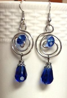 Wire earrings with blue bead and dangle