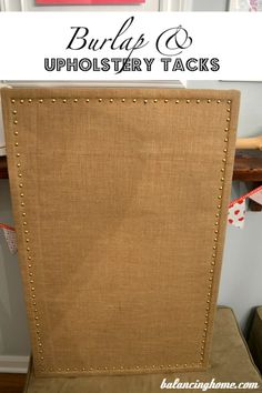 Updated Homemade Cork Board.  Love the look with the studs and its so easy!