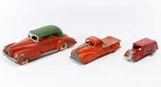 """Lot 586: Wind-Up Metal Toy Cars; Three items including a Marx """"Coast to Coast"""" delivery truck, a truck cab and a green and red LaSalle car marked """"Made in USA"""""""