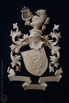 Coat of arms - Crest carved in limewood | Coat of arms Cornielje (Switserland) | A Coat of Arms-Crest carved in wood, painted and gilded | http://www.patrickdamiaens.be