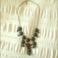 Bubble Necklace Green necklace. The chain around the back of neck is turning a little. Charming Charlie Jewelry Necklaces