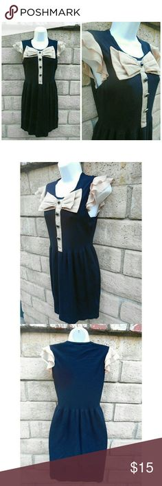 Twelve and Twelve Bow Dress, Size Medium Super cute Twelve and Twelve Los Angeles black and cream colored above the knee dress in size Medium. Viscose and Nylon blend. Very good condition. Twelve and Twelve Los Angeles  Dresses Mini