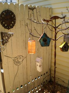 Some of our birdhouses and outdoor lanterns (Tree not for sale)