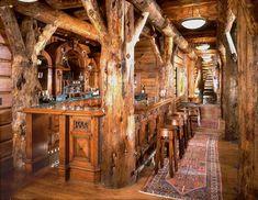 Incredibly rustic bar area in log home gameroom.  Montana/Idaho Log Homes, Victor, Montana