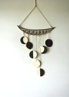 Hand carved ceramic wall hanging inspired by phases of the moon. Pieces are all hand tied using natural hemp cords. Can be hung indoors or out doors. Can
