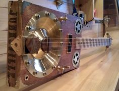 Finally found a use for Pinterest: cool instruments. Cigarbox Guitar - `Relic Resonator` #oneofakind #awesome #cigarboxguitar