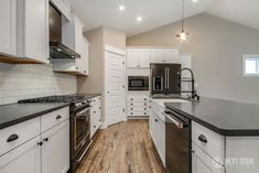 Georgetown Kitchen with Black Granite and White Kitchens #BeautifulKitchen #BlackGranite #NewHome #EastbrookHomes