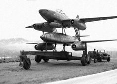 "Me-262 ""Mistel"" (Mistletoe), a flying-bomb version of the Me-262 with no cockpit, a warhead in the nose, and a simple autopilot system. The flying bomb was to be controlled by a piloted Me-262 attached to a frame on top, with the whole clumsy assembly taking off on a big trolley that was dropped after take-off. The piloted Me-262 would release the flying bomb after pointing it at a target."