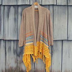 Painted Sky Fringe Sweater. $58. Spool 72. Love the mustard fringe on bottom!!