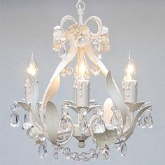 Lauren's room? Timeless elegance highlights this chandelier, sparkling with crystal adornments. This 4-light hanging fixture features floral styling and a white finish.