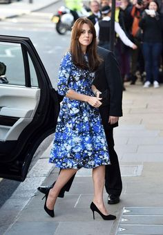 For her first amazing outfit of the day, Kate Middleton wore a blue Tabitha Webb dress in a space print. Click to see the pics of her second (it's a custom Jenny Packham gown!)