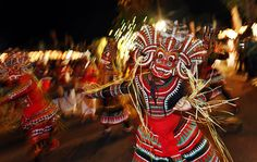 Colombo, Sri Lanka — A traditional mask dancer performs in an annual Buddhist procession. Hundreds of dancers, drummers, decorated elephants and Buddhist monks took part in the event, which is held on a full moon.    PHOTOGRAPH BY: GEMUNU AMARASINGHE / ASSOCIATED PRESS