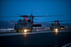 Two Sikorsky HH-60 Pave Hawk rescue helicopters from the 34th Weapons Squadron at Nellis AFB, Nev., taxi down the runway at Gowen Field, Idaho, after arriving for training, March 8, 2013. (Air Force photo by SrA. Brett Clashman)