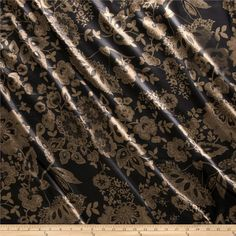 Charmeuse Minsk Black/Brown from @fabricdotcom  Lightweight and silky soft, this charmeuse satin is perfect for blouses, dresses and skirts - especially on the bias. It's also perfect for lingerie and binding baby blankets! Colors include brown and black.