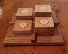 Plywood assembled into Tea light candleholders. Base made from Banak wood (I think that's what it is)