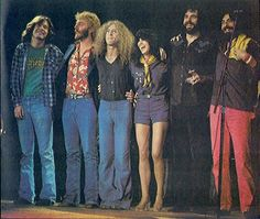 The Linda Ronstadt band on the Simple Dreams 1977 tour -- L-R Dan Dugmore (peddle steel guitar and other instruments), Andrew Gold (lead and rhythm guitar and keyboard), Waddy Wachtel (lead and rhythm guitar) , Linda, Kenny Edwards (bass) and Rick Marotta (drums)