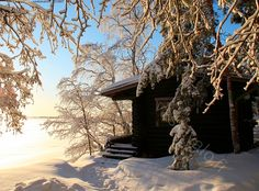 Cottage by a lakeside in the snow :)