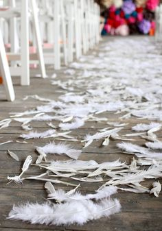 Love these feathers instead of petals in the aisle. From Jeremy + elsie larson wedding (A Beautiful Mess blog) #feathers #wedding