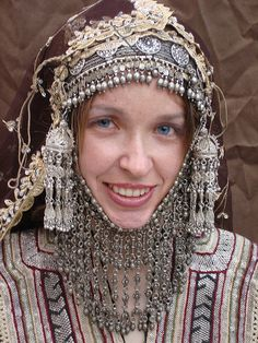 Traditional Yemeni wedding jewelry and clothes. That's a lot of silver, all made a long time ago in Yemen by Jewish silversmiths.