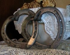 Horseshoes welded together to form hearts. This would be great for Chey!