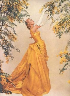 Elegant dress in yellow ~ vintage advertisement for Modess.
