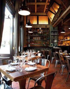 taking ques from the best... this NY city restaurant cleverly maximizes on space w/ hinged leaf tables to accommodate larger parties as needed & no problem having these hardware hinges exposed because of their decorative element quality...
