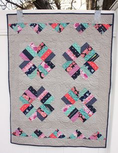 I'm continuing to knock past projects off the WIP/UFO list. This is a little baby quilt that I started last summer.It's called Blossom and it's from the book Fat Quarter Stylefrom the Fat Quarter Shop. I modified the pattern just slightly to use some of the leftovers from piecing the blocks. Finished it measures 33″ x 43″. I just picked it up from Sew Shabby Quilting last weekend so that I could bind and finish. This quilt has so much negative spacesoI told Melissa that she could jus...