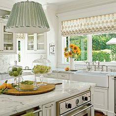 Classic white kitchen with pleated fabric pendant light, marble counters - Lee Ann Thornton, Photograph by Dominique Vorillon, Coastal Living