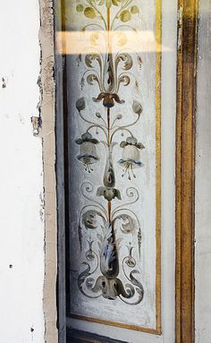 North side doors of Château de Bagatelle in the 16th arrondissement of Paris. Cream base with blues & warm hues