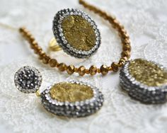 gold oval #drusy natural raw stone clay necklace, bracelet, ring earrings set, druzy jewelry, natural stone, pave cz zirconia druzzy, Geode Slice, Paved tassel Chain necklace, macrame bracelet, stud earrings and resizable ring turkish handcrafted jewelry set.  Polymer clay pendant necklace jewelry hematite polymer clay with rhinestones fashion, elegant, simple, trendy, chic necklace. Necklace pendant back base is zinc and 18 K gold coated.