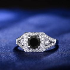 Beautiful black diamond engagement ring that is very comfortable to be worn daily and was designed with a lot of thought and love. This would be the perfect ring for proposal or a gift for your beloved. SELECT CENTER DIAMOND: Choose the size of the center diamond for this ring before