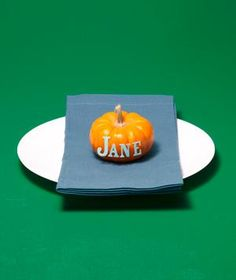 Spell out guests' names with adhesive letters on pumpkins (or write them with a permanent marker); send the mini gourds home as party favors.