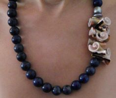 Lapis Lazuli. http://www.daliakoss.com/products/lapis-lazuli-necklace-11