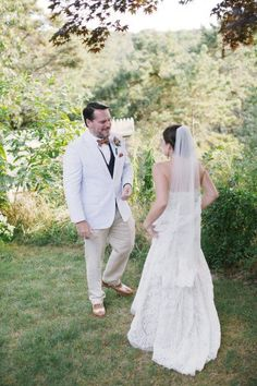 Bride In A Lace Wedding Dress And The Groom Seersucker Suit With
