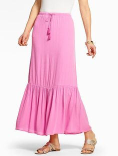 A feminine ruffled pink maxi skirt is dinner date approved.