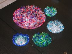 Large melted bead bowl and 4 small melted bead bowls.