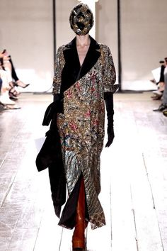 The final ensemble at Maison Martin Margiela Artisinal, where a beautifully ornate 1930s Chinese opera costume was fused with a wool coat.  Production time 118 hours.  _