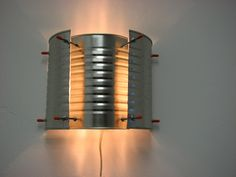 Imagine the punch patterns you could do!.....tin can wall sconce (Imagine it painted!)