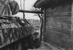 Wiking Panther is seen in a probably posed, but believable, battle shot in the Kovel sector, spring 1944. The tank is overall Sand Yellow with broad brush strokes of Red Brown and Olive Green. If this is an actual combat photo, the grenadier is a little close to the Panther for the comfort.
