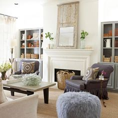 Bookshelves with Base Cabinets Flanking Fireplace    bhg