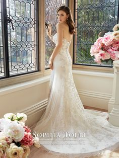 a sexy curve accentuating wedding dress silhouette for