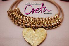 Hermoso collar en cadena, detalle corazón dorado.