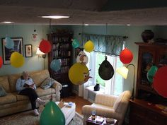 Clever suspending the balloons from the ceiling and decorating with construction paper to look like the Angry Birds.