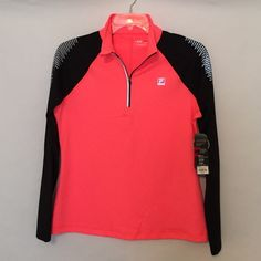 Fila Sport pullover NWT BRAND NEW Fila Sport Running pullover, quarter zip, coral/black. Reflective elements at shoulders to reflect light during dawn and dusk hours. 88% poly/12% spandex. Also available in royal blue/black in a separate listing. Fila Tops Sweatshirts & Hoodies