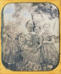 A wonderful picture: all that printed material has to date to the mid-1850s. Mother could really sew, and those store-bought belts must have been highy prized by the girls.